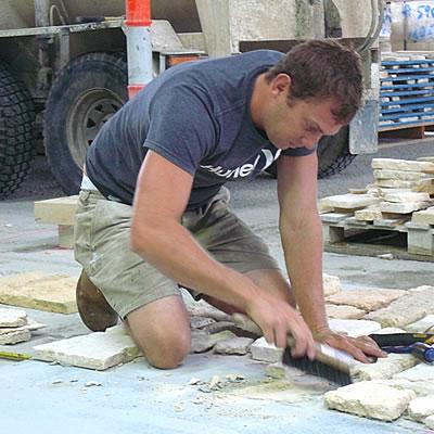 Matt laying out the stone wall.