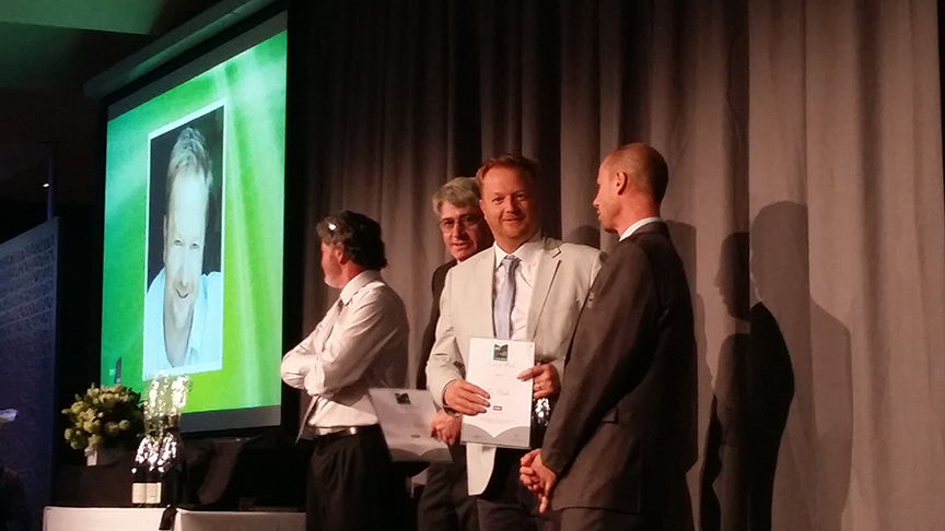Ian Barker on stage accepting his merit award at the 2015 Landscaping Victoria awards