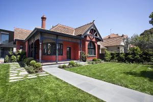 Ian Barker Gardens has designed a traditional front garden with lawn, crazy pavers and perennial planting to perfectly complement the architecture of this heritage property in St Kilda